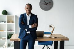 Free Handsome Cheerful African American Executive Business Man At The Workspace Office. Royalty Free Stock Photo - 129607855