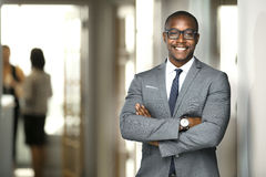 Free Handsome Cheerful African American Executive Business Man At The Workspace Office Royalty Free Stock Photo - 86822385