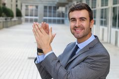 Handsome cheerful businessman clapping  Royalty Free Stock Photos