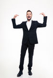 Handsome cheerful businessman in suit laughing and pointing on himself Stock Photo