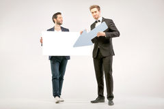 Handsome and cheerful guys advertising sales Royalty Free Stock Photo