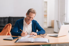Handsome cheerful man holding a pencil Royalty Free Stock Photography