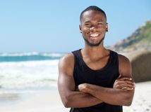 Handsome cheerful man smiling at the beach Royalty Free Stock Photos