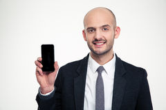 Handsome cheerful young businessman showing blank screen smartphone Royalty Free Stock Photography