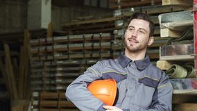 Heavy industry manufacturer relaxing after work smiling looking away royalty free stock photography