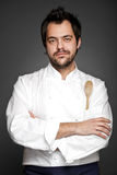 Handsome chef. Posing with hands crossed stock photography