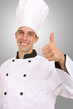 Handsome Chef. A handsome man chef signaling success with thumbs up stock photos