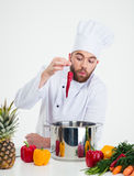 Handsome chef cook preparing food i Stock Photos