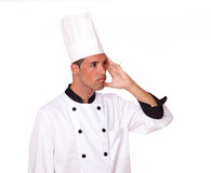 Handsome chef with headache looking at people Stock Image