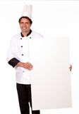 Handsome chef holding a blank placard of copyspace Stock Photo