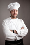 Handsome chef posing Stock Photos