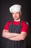 Handsome chef posing against black background Royalty Free Stock Images