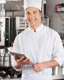 Handsome Chef With Tablet Computer Stock Photo