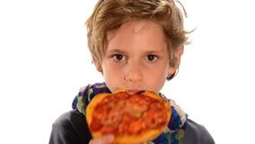 Handsome child eating a pizza stock footage