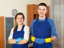 Handsome cleaners cleaning living room Royalty Free Stock Photography
