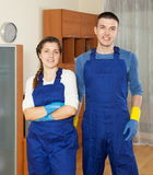 Handsome cleaners team cleaning floor Stock Image