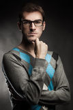 Handsome and Clever!. Young man handsome and clever, looking at camera. An improved nerd royalty free stock image