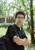 Handsome college student. Male Indian / Asian college student in the campus holding backpack Stock Image