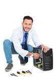 Handsome computer engineer working at open computer Stock Photography