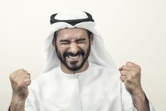 Handsome Confident Arab businessman expressing success, Arabian Stock Image