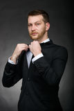 Handsome confident business man in black suit stock photo