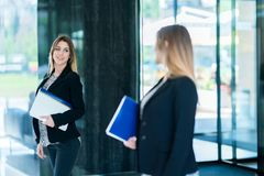 Handsome confident business woman holding files. Portrait of a h royalty free stock images