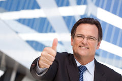Handsome, Confident Businessman with Thumbs Up Stock Images