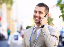 Handsome and confident businessmantalking on his cell phone Stock Photo
