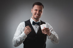 Handsome confident man holding cards looking at camera. Royalty Free Stock Photography