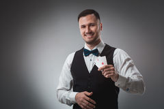 Handsome confident man holding cards looking at camera. Stock Images