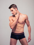 Handsome confident man with muscular body Royalty Free Stock Photography