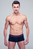 Handsome confident man with muscular body Royalty Free Stock Photo