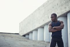 Portrait of attractive African athlete coming home after workout at fitness club Royalty Free Stock Photography