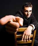 Handsome confident young man with finger pointing. Portrait of handsome confident young man with finger pointing royalty free stock images