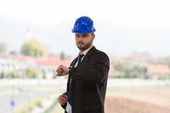 Handsome Construction Manager Looking At His Watch Stock Images