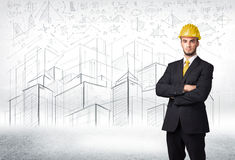 Handsome construction specialist with city drawing in background Stock Images