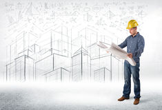 Handsome construction specialist with city drawing in background Stock Photos
