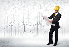 Handsome construction specialist with city drawing in background Royalty Free Stock Photos