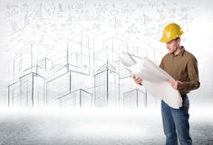 Handsome construction specialist with city drawing in background stock image