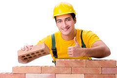 The handsome construction worker building brick wall Royalty Free Stock Images