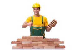 The the handsome construction worker building brick wall Royalty Free Stock Photo