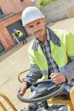 Handsome construction worker on building industry construction site Royalty Free Stock Images