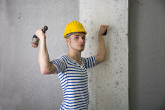 Handsome construction worker with hard hat and hammer Royalty Free Stock Images