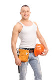 Handsome construction worker holding a helmet Royalty Free Stock Photos