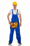 Handsome  construction worker. With tool-belt, full lenght Stock Photography