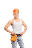 Handsome construction worker with a tool belt Stock Images