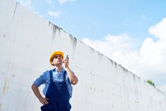 Handsome Construction Worker Using Walkie-Talkie royalty free stock photo