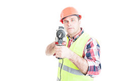 Handsome constructor holding electric drilling machine Stock Image