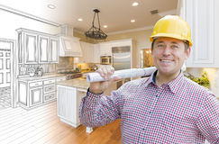 Handsome Contractor in Hard Hat Over Custom Kitchen Drawing and Photo Royalty Free Stock Photography