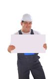Handsome contractor holding a banner. Royalty Free Stock Photos